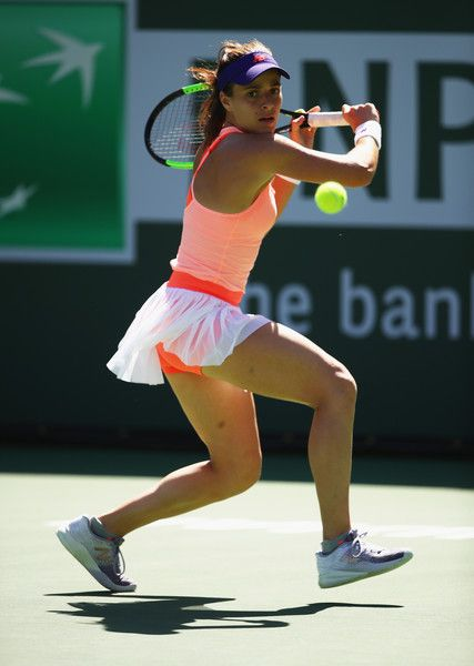 Nicole Gibbs Photos Photos - Nicole Gibbs of the United States plays a backhand against Heather Watson of Great Britain in their first round match during day three of the BNP Paribas Open at Indian Wells Tennis Garden on March 8, 2017 in Indian Wells, California. - BNP Paribas Open - Day 3
