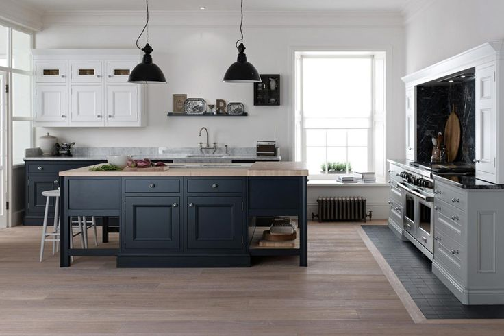 Use different shades of grey in the kitchen to create zones. This is by kitchensbybroadway.co.uk