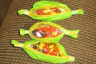 Thanksgiving Indian Corn Treat bags... snack ziplock filled w/ Reeses pieces and covered in yellow and green tissue paper... taped at ends