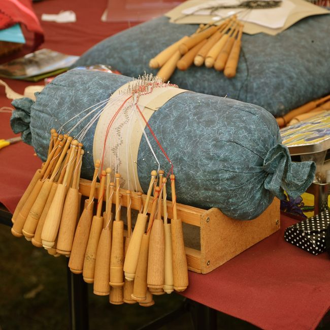 Four antique hooded bobbins