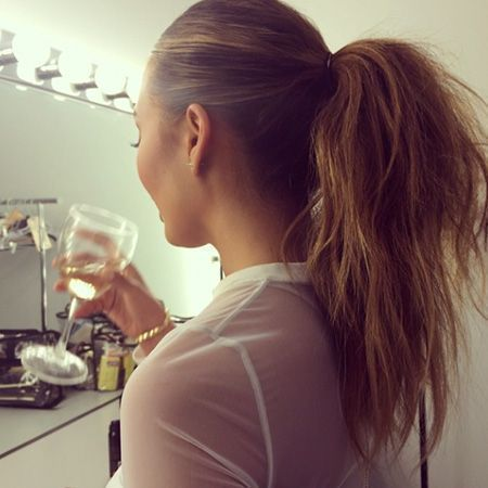 We love supersleek ponytails, but we're also huge fans of big, poufy ponytails, like the one Chrissy Teigen is seen wearing, here. Want to know how it's done? We asked Teigen's hairstylist Jen Atkin how to try it on your own. (Hint: It involves teasing.) | http://allure.com