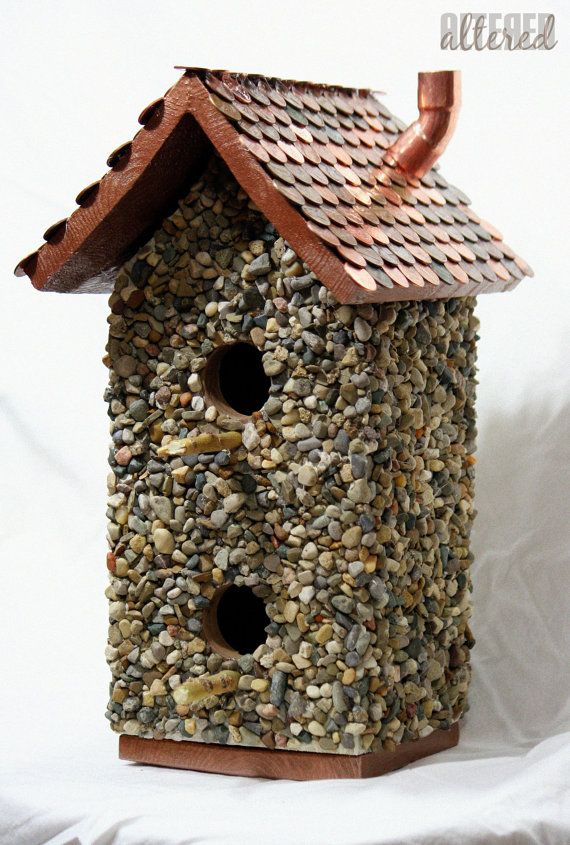 Stone And Wood Birdhouse With A Roof Made Of By