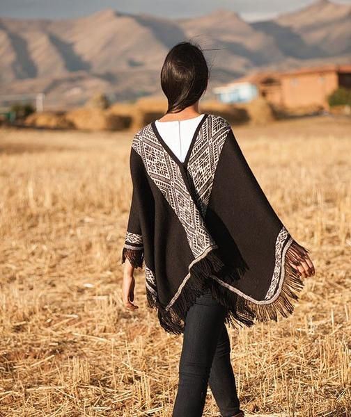 The Chaska Alpaca Poncho is an innovative, modern take on an ancient garment: the traditional woven poncho has been keeping the inhabitants of the Andean highlands warm for centuries. Woven in luxuriously soft, un-dyed black alpaca fiber, this statement-making women's poncho adds an elegant touch of Peru to your winter wardrobe!
