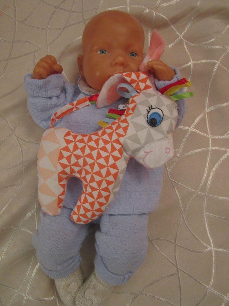 Voici ce que je viens d'ajouter dans ma boutique #etsy : doudou petit âne fait main, en tissu imprimé et polaire orange tendre http://etsy.me/2n8qkK5 #jouets #orange #blanc #doudouane #petitane #animaux #bebe #enfant #cadeaunaissance