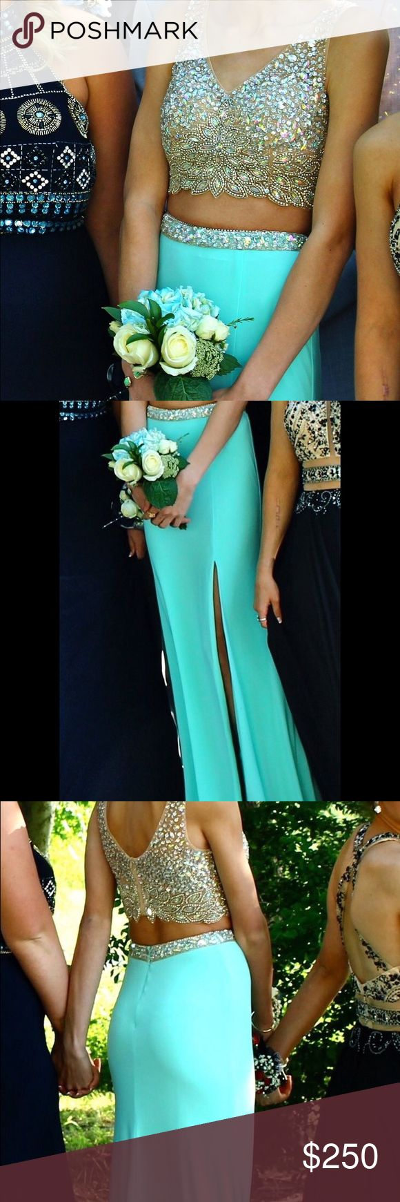 Turquoise Two-Piece Prom Dress with Beaded Top Hello! I am selling my Two-piece turquoise prom dress with a beaded top! It has a slit in the side and a small train. I am 5'7 and I wore 3' heels with this dress. It has only been worn once and is still in excellent shape. THIS IS A SIZE 3 DRESS Dresses Prom