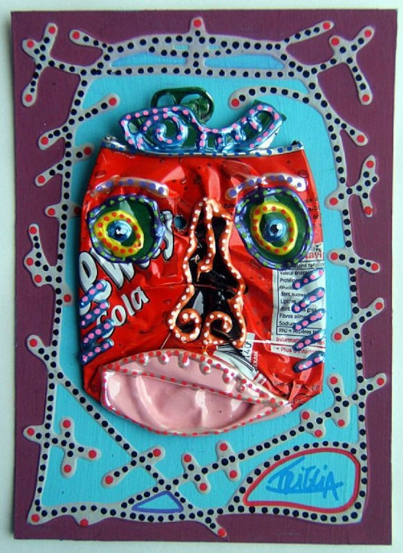 Smashed soda can face. This has Haiti art project written all over it. Recycled and colorful and voodoo looking!