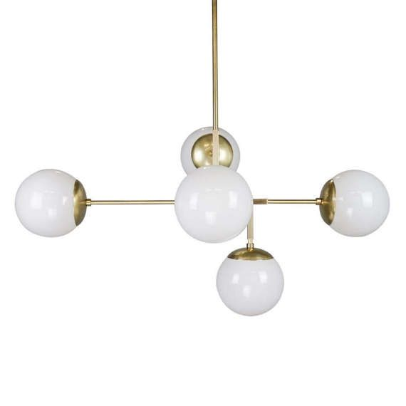 The Prisma globe chandelier is crafted using square and round rods connected to seamless globe holders to create a midcentury modern statement piece.  Lead time: 1-2 weeks.  Measurements: - Length: 33 in - Width: 20 in - Height: 40 in (with all rods installed) - Weight: 7 lbs  Features: - Five hand blown glass globes (6 diameter) with seamless globe holders - Polished and lacquered solid brass finish - Canopy kit and hardware included - Five medium base (E26) light sockets - Rating: 120V…
