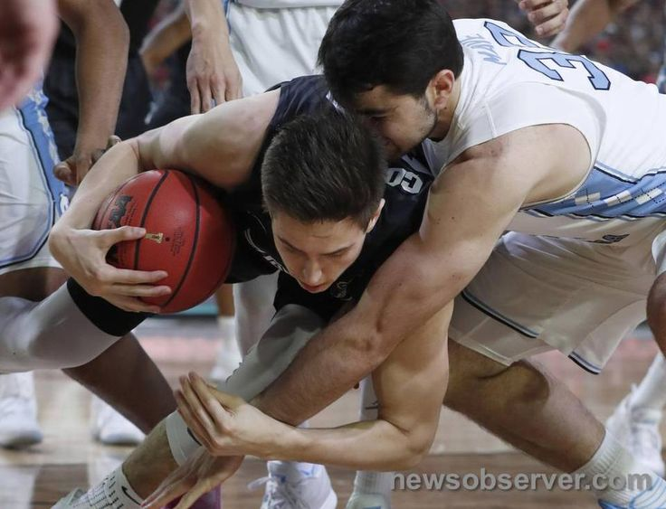 North Carolina's Luke Maye (32), right, fights with Gonzaga's Zach Collins (32) for the ball during the first half of UNC's game against Gonzaga in the NCAA Division I men's basketball national championship game at the University of Phoenix Stadium in Glendale, AZ, Monday, April 3, 2017.