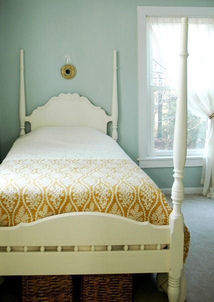 Wall color = Sea Salt by Valspar. LOVE the gold fabric on the bed.