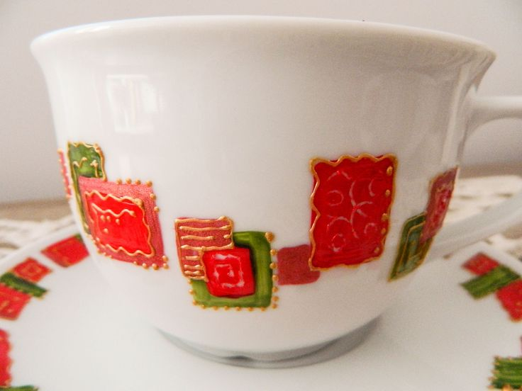 Cocoa cup, hand painted with red and green rectangles.