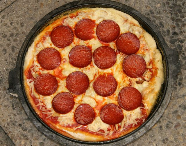 Dutch Oven Pizza.  Trying this this weekend.