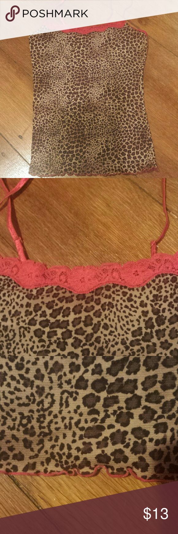 Late 90s 2000s sheer leopard print cami top No tags but the brand might have been Rampage. Mesh, sexy, super stretchy tank top with spaghetti straps, in cheetah print. Has red lace at the top and red lettuce edge hem. Really cute as a pajama top or just for everyday in the summer. Can fit xs to m. Bust is 13.5 to 18 inches. I have a matching skirt for sale. Tops Tank Tops