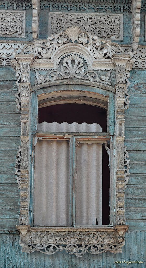 elaborate window architectural detail. soft blue and taupe