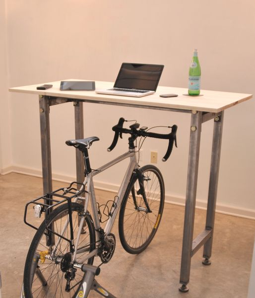 The kickstand desk. Ride your bike then stick it at your desk and keep peddling. Get exercise and someplace tho store your bike! Looks like it could be used as a stand-up desk when the bike's not there.