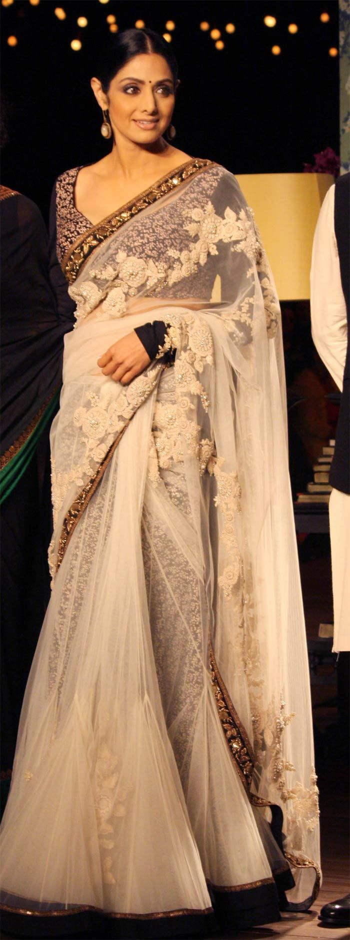 An elegant white chiffon Sabyasatchi sari.