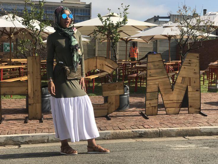 Wearing the khaki Frill T-shirt dress with a fanny pack www.fabulousinhijab.co.za