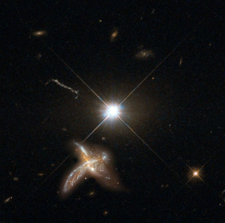 An artist's impression of a quasar and neighboring merging galaxy. The galaxies observed by Decarli et al are so distant that no detailed images are possible at present. This combination of images of nearby counterparts gives an impression of how they might look in more detail. Image credit:  Max Planck Institute for Astronomy / NASA / ESA / Hubble.
