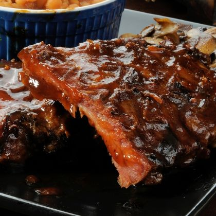 Scrumptious grilled ribs with a cherry chili glaze... saucy and amazing.. Grilled Ribs With Cherry Chili Glaze Recipe from Grandmothers Kitchen.