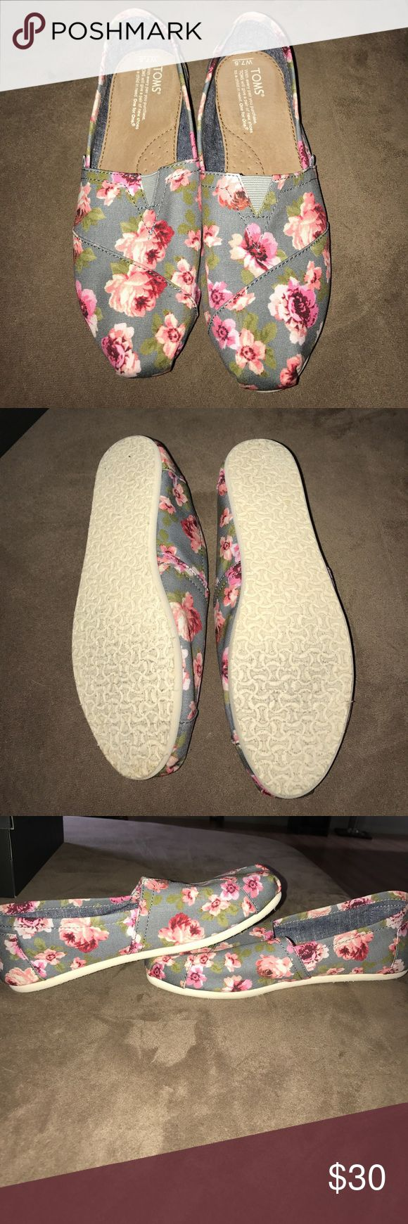 Floral Toms 👟 Beautiful and comfortable pair of gray Toms with pink roses. Worn like maybe twice you can see there is no wear on them size 7.5. Never wear them so selling. Toms Shoes Flats & Loafers