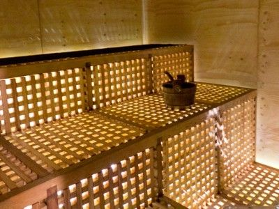 """Hot Cube Sauna A Hot Cube sauna is a very simple concept – an """"easy to assemble, easy to transport"""" wooden sauna that can be built above water on pontoons or pilars. The sauna has a wooden rack floor from which light and air enter – distractions from outside world are minimized."""