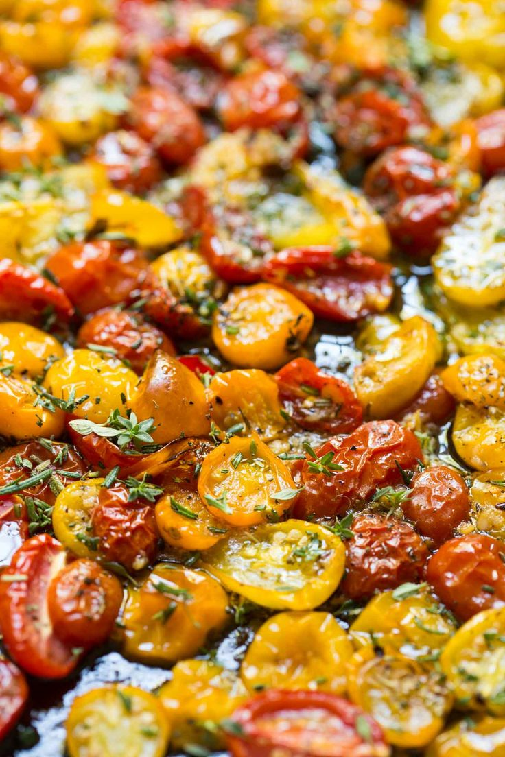 Garlic and Herb Roasted Tomatoes - these incredibly flavorful roasted tomatoes are wonderful in salads, pasta dishes, on pizzas, sandwiches - on anything!