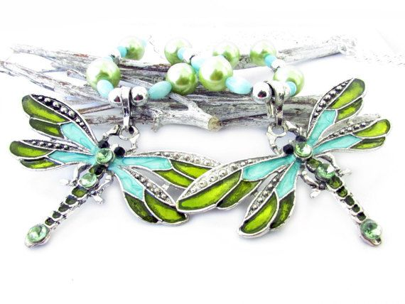 These are absolutely GORGEOUS dragonfly curtain tiebacks made with a silver metal with blue and light green dragonfly bead focal point. Perfect drapery tiebacks for the shabby chic decor, or a little girls room. These have coordinating blue oval beads and light green pearls with