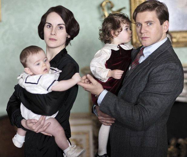Lady Mary played by Michelle Dockery with Baby George and Tom Branson played by Allen Leech with baby Sybbie
