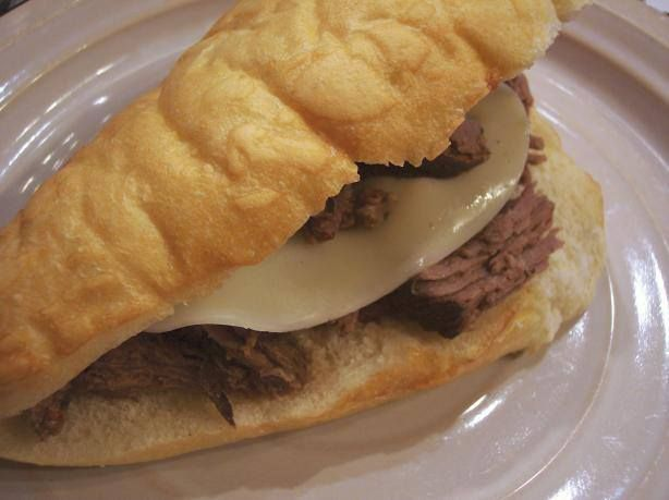 Italian Arm Roast Sandwich   3 LB ROAST 1 ONION QUARTERED CANNED BEEF BROTH (10 - 12 OZ) AU JUS DRY MIX PACKET (1 OZ) DRY ITALIAN DRESSING MIX (.7 OZ) 1/2 TSP SALT 1/2 TSP GROUND BLACK PEPPER  PLACE ROAST IN CROCK POT. SCATTER ONION AROUND MEAT. POUR BROTH OVER MEAT. SPRINKLE AU JUS MIX, ITALIAN DRESSING MIX, SALT AND BLACK PEPPER OVER ROAST. COVER. COOK FOR 6-8 HOURS ON LOW, OR UNTIL VERY TENDER. BROIL ROLL WITH PROVOLONE CHEESE FOR A FEW SECONDS TO BROWN CHEESE.