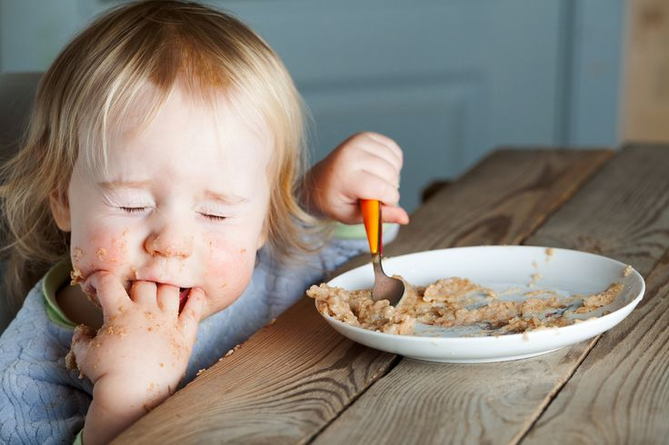 BABY FOOD BASICS: WHAT YOU SHOULD KNOW ABOUT FEEDING YOUR BABY - Kamo - baby eating porridge at the table