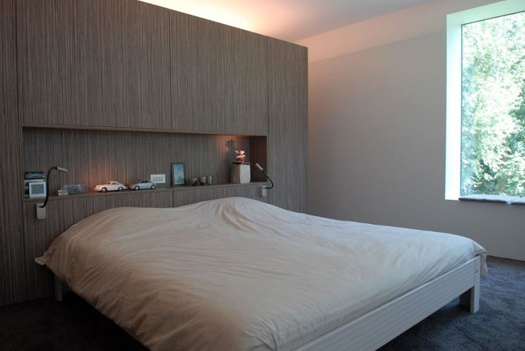 Great built-in niche that serves as a headboard and good uplighting from closet behind bed