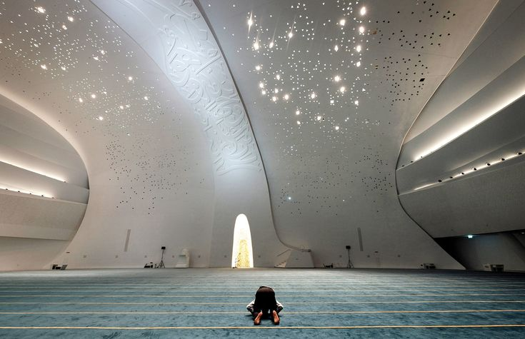 EDUCATION CITY MOSQUE This mosque in Doha is elevated on five piers, that represent the five pillars of Islam—shahada (knowledge), salat (prayer), zakat (charity), siyam (fasting) and hajj (pilgrimage)—each engraved with Quranic verses in elegant calligraphy.  PHOTOGRAPH BY BONNIE JO MOUNT, THE WASHINGTON POST/GETTY IMAGES