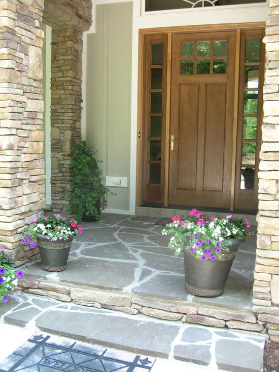 Like the stone porch and the stacked stone pillars outside - Exterior doors that open to the outside ...