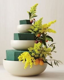 When to start: 1 day before    1. Soak floral foam in water, and cut pieces to fit inside each bowl; the foam should extend 2 or 3 inches above the rim.    2. Stack bowls on top of one another, keeping them centered.    3. Attach lemons and kumquats to wooden skewers. Insert them into the floral foam, then fill in the gaps with flowers until the blocks are covered. Refrigerate overnight.