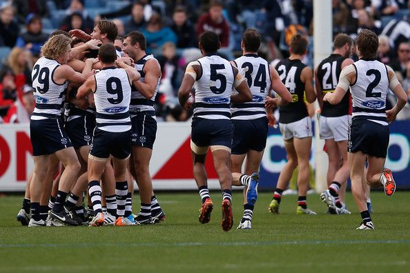 Geelong players congratulate Darcy Lang after he kicks his first goal in AFL during the round 13 AFL match between the Geelong Cats and the St Kilda Saints at Skilled Stadium on June 15, 2014 in Melbourne, Australia.