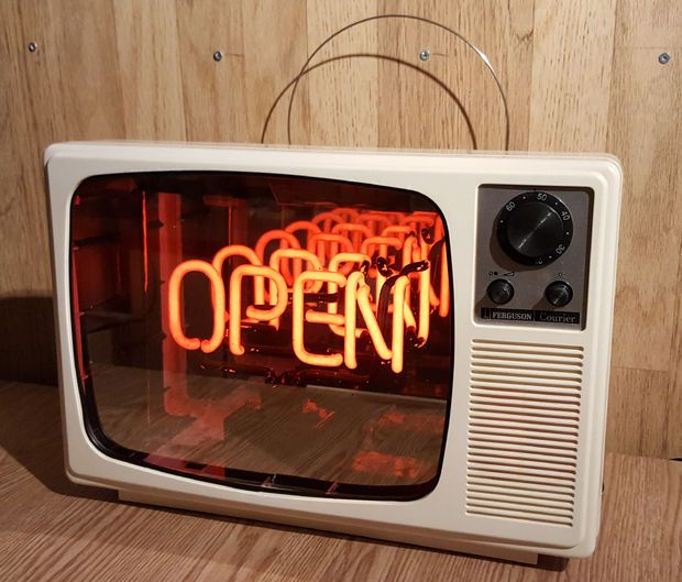 "A 1970s Ferguson Courier TV that has been converted into an infinity mirror with a neon ""Open"" sign inside."