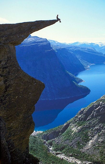 Trolltunga, Norway. Trolltunga is a piece of rock that hangs out of the mountain about 2,000 feet up in the air. The Troll's Tongue (translation in English) is available to hikers from mid-June to about mid-September.Fjord - Trolltunga, Norway. On my list for the next trip!!!