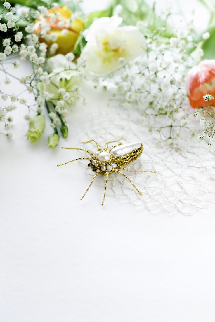 Hand embroidered Brooch Spider by Eve Anders. Handmade Jewelry design.