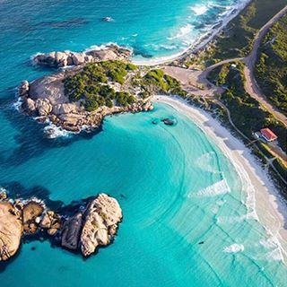 Twilight Beach from a birds view in Australia. Here the transparent turquoise water meets powder fine white sand. The beach is popular surfing spot. The place is only 20 minute drive away from Esperance and is a perfect destination just to relax or take a swim.