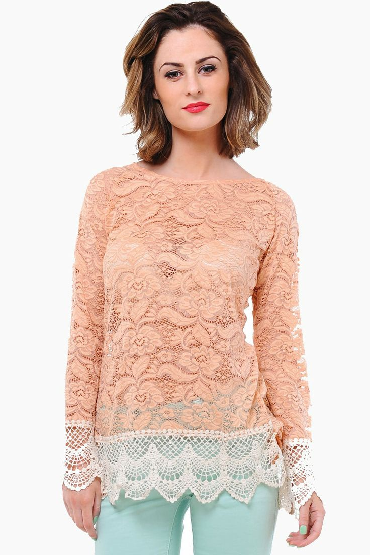 Turn heads in this ultra-pretty and feminine lace top. Looks great paired with skinny jeans and platform heels.  - Crochet hem and cuffs - Open back - Sheer lace - Gold Button Detail at Back
