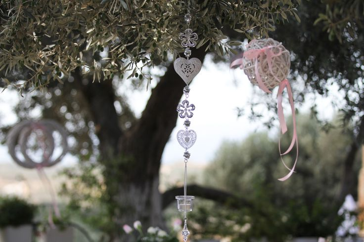 wedding decoration with metal hearts and candles