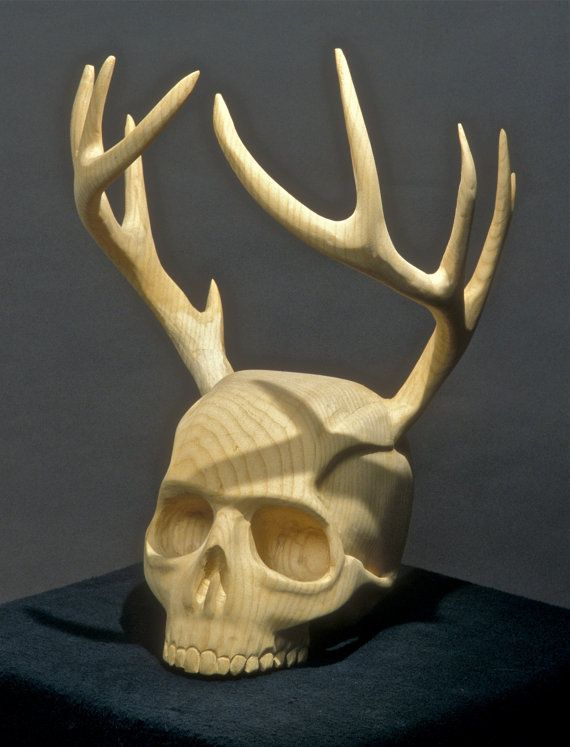 The Woodsman Urn by Jason Tennant. Woodcarving of skull and wooden antlers. $750.00, via Etsy.