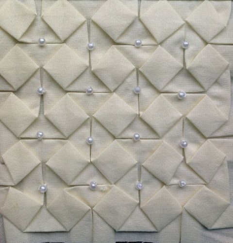Beaded origami textiles tutorial using a grid to create a repeating folded pattern - structural fabric manipulation; creative sewing techniques