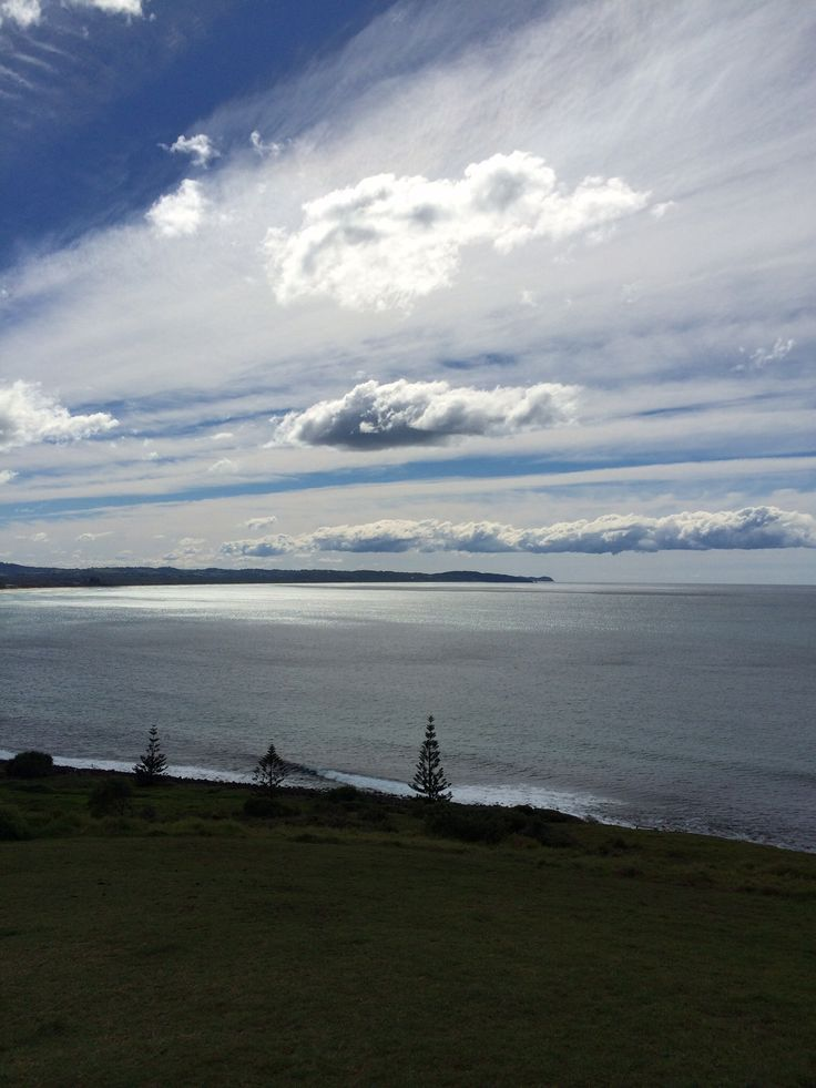 Lennox Head, looking back to Byron Bay NSW. This was the light in the sky as clicked on my iphone ;)