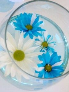 floating flowers is a fun idea...could be combined with aqua colored water, floating candles...and rubber duckie pairs!