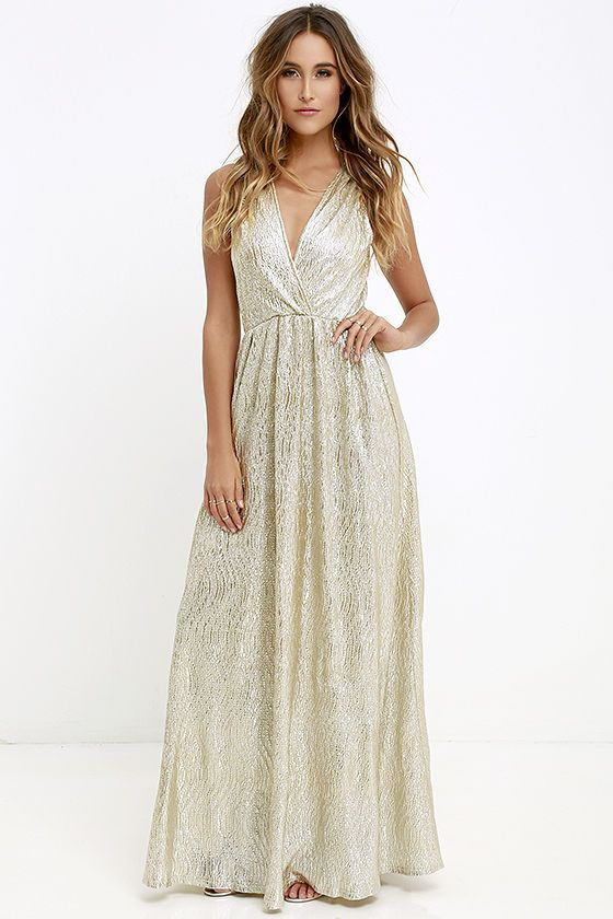 AS SEEN IN REAL SIMPLE! With its glimmering silver-meets-gold fabric, the All that Shimmers is Gold Light Gold Maxi Dress will have you shining like a real starlet! Sultry surplice bodice forms a deep V in front and back, while gathered fabric at the shoulders makes this sleeveless dress really shine! Elasticized waist and maxi length form a feminine shape.