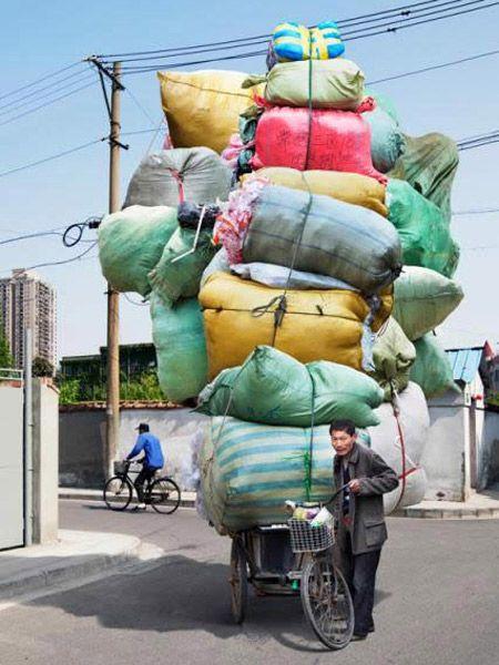 PHOTOS: Portraits Of Shanghai's Burdened Bikers