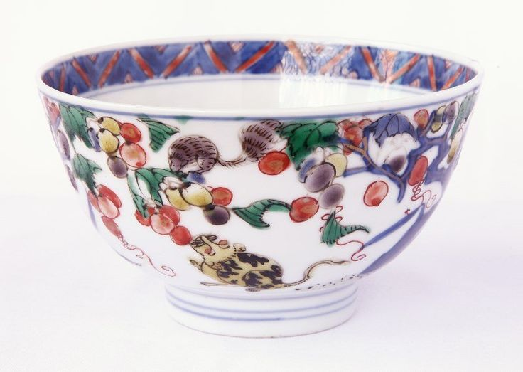 Chinese Kangxi Dynasty, (1661-1722) Porcelain Bowl, and Saucer, decorated with trees of fruit with cat and squirrel, in tones of green, red, orange, yellow and underglaze blue, square mark within double circle to base, d 10.5cm (bowl), d 15cm (saucer),