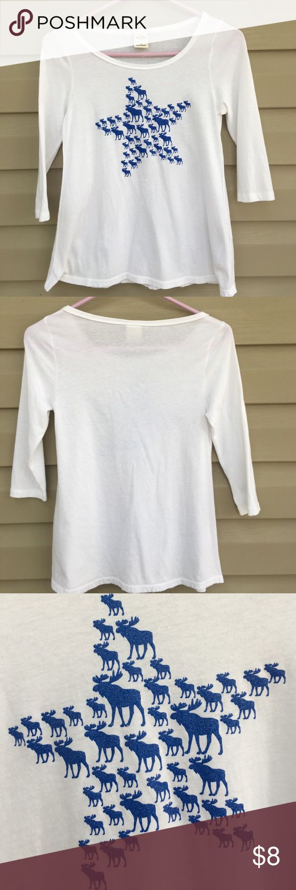 Abercrombie girls shirt Nice girls 3/4 length white shirt. Glitter moose in shape of star on front. 60% cotton 40% polyester no stains or holes abercrombie kids Shirts & Tops