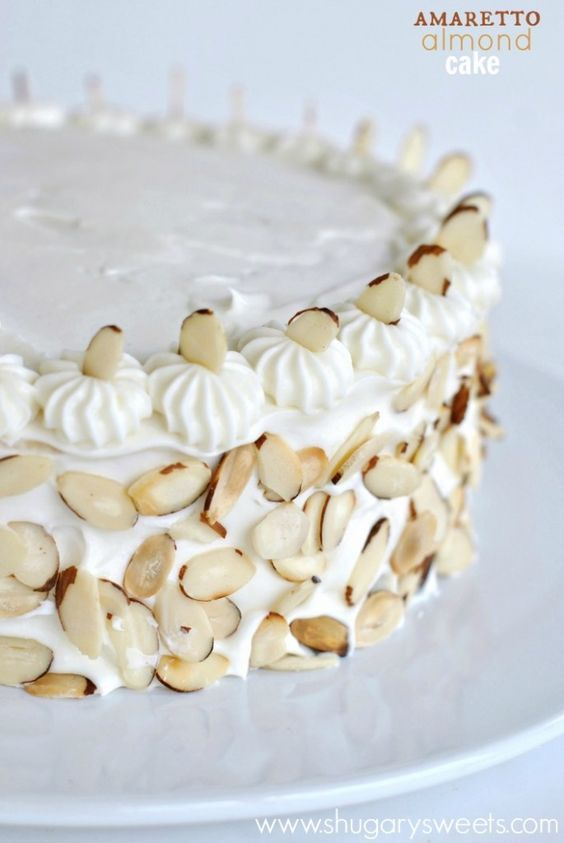 Perfect White Cake recipe topped with an Amaretto Cream Cheese frosting and toasted almonds.