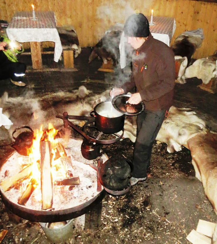 Chef preparing salmon soup at tepee restaurant. Nuuksio, Finland. www.kiviluoma52.me